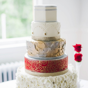 Glam red and metallic wedding cake
