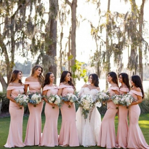 Bridesmaids in blush off the shoulder gowns