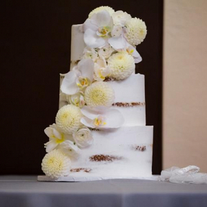 White semi naked cake with fresh orchids