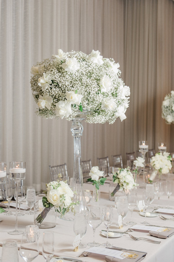 Tall rose and baby's breath wedding centerpiece
