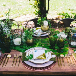 Tropical greenery wedding tablescape