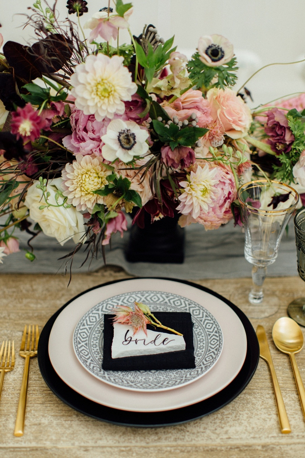 Blush, burgundy, and black place setting