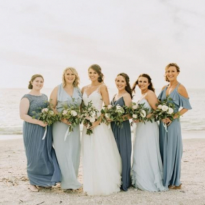Mismatched long blue bridesmaid dresses