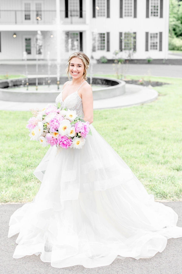 Bride with lush pink and white peony bouquet