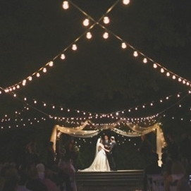 Nightime ceremony with string lights
