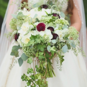 Green and white bouquet with red ranunculus