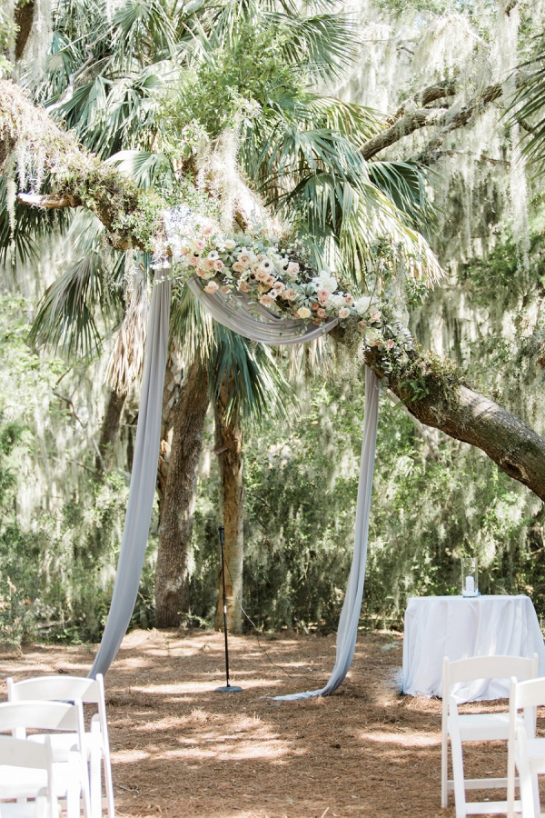 Draping and floral tree ceremony backdrop