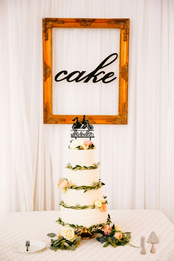 White wedding cake with silhouette topper