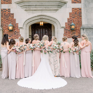 Bridesmaids in mismatched blush and floral print dresses