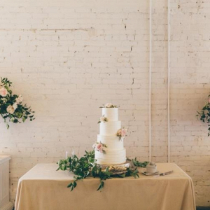 Classic white wedding cake with fresh flowers