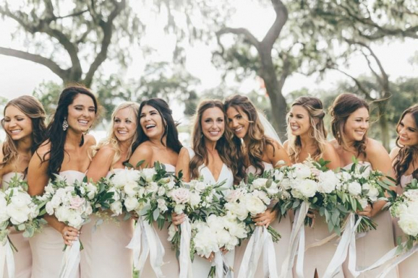 Bridesmaids in strapless blush gowns