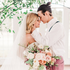 Peach and mauve wedding portrait