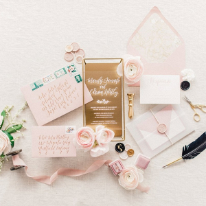 Acrylic wedding invitation with gold calligraphy