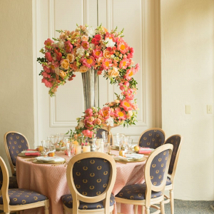 Tall orange floral centerpiece with trailing florals