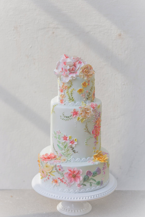 Peach and pink flower painted wedding cake