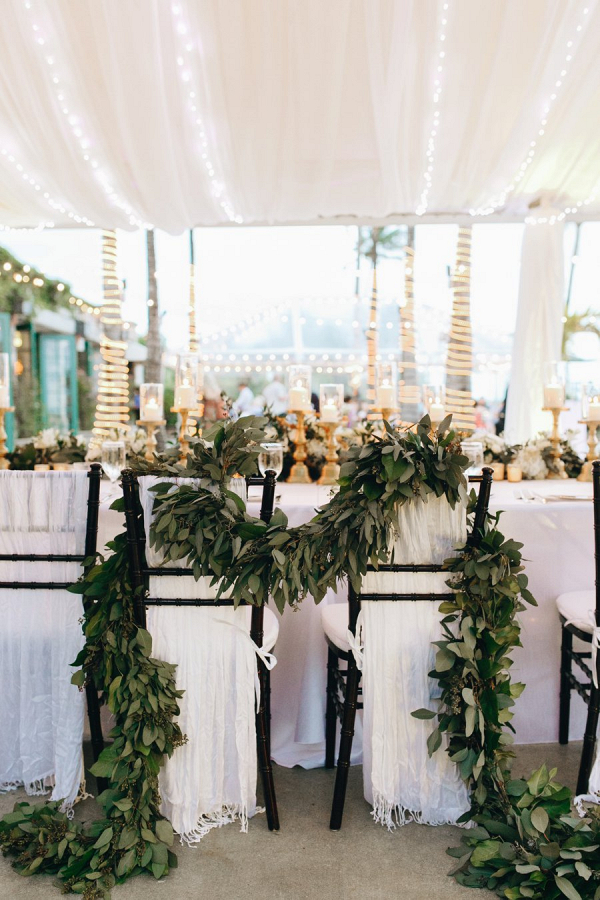 Chairs covered in greenery