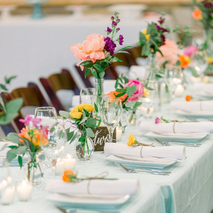 Colorful wedding tablescape with bud vases