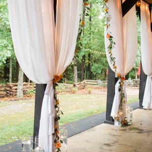 Fabric draping on barn pillars