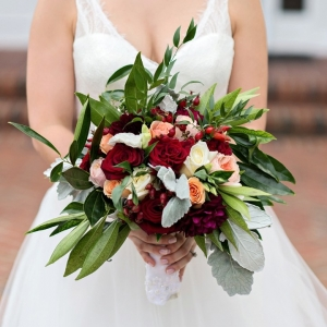 Rustic and romantic red bouquet with greenery