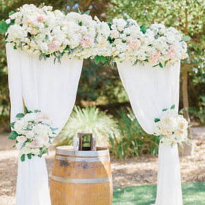 Floral and draping ceremony backdrop