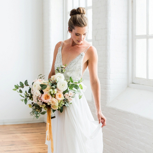 Ballet bride with peach bouquet