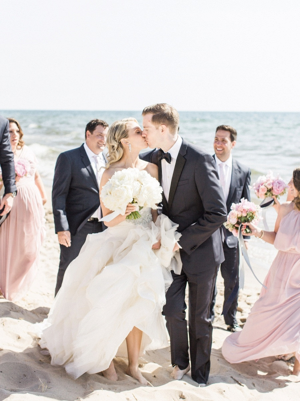 Blush bridal party on beach