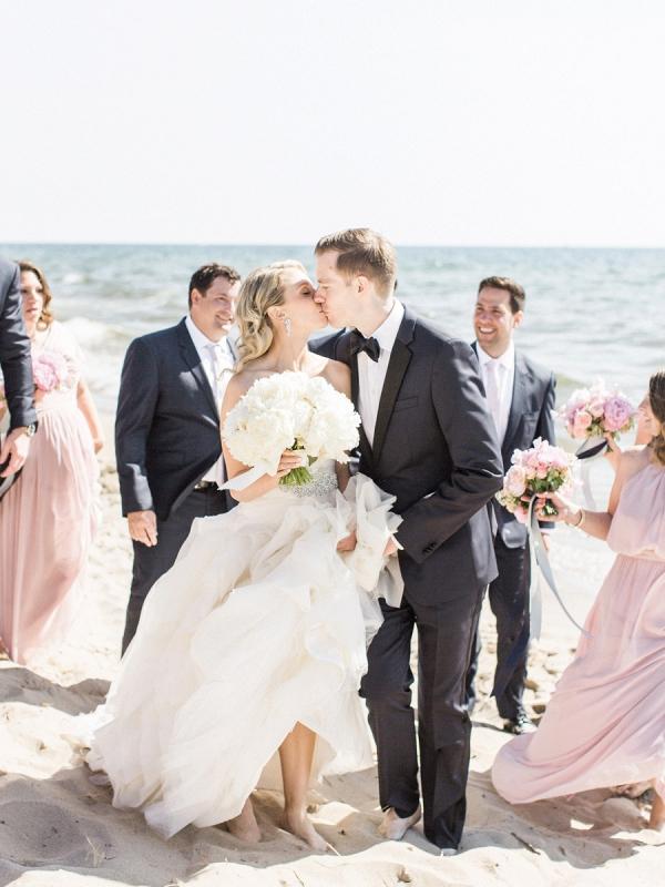Blush bridal party on beach