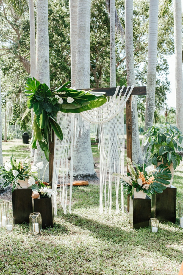 Tropical boho ceremony backdrop