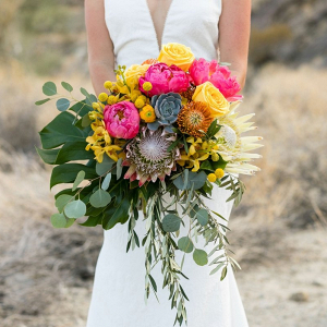 Bright peony and protea bridal bouquet