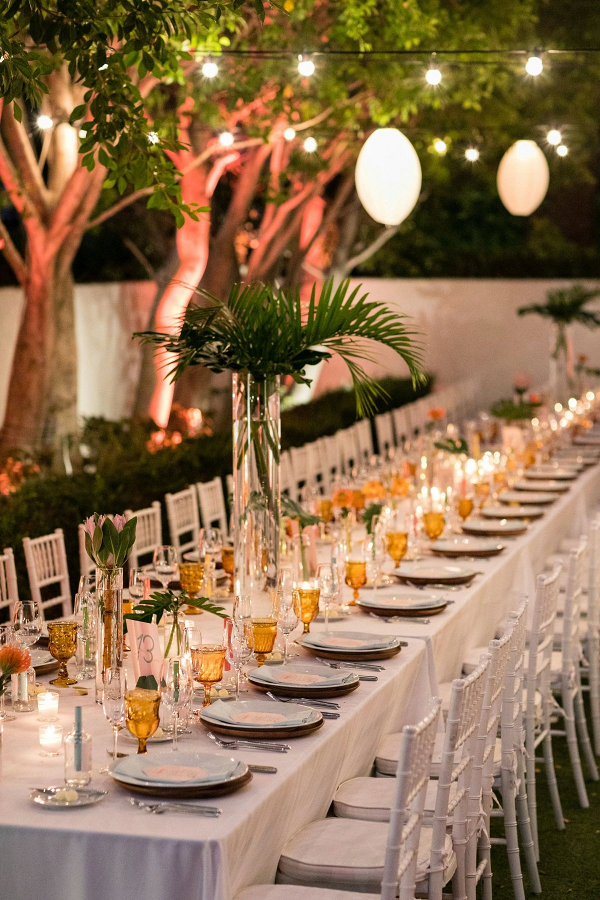 Tropical wedding reception with palm centerpieces