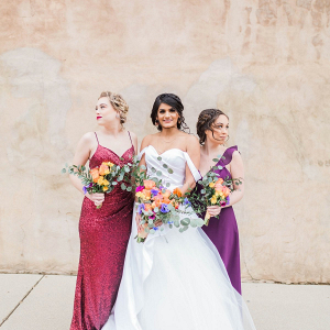 Jewel toned bridal party in mismatched dresses