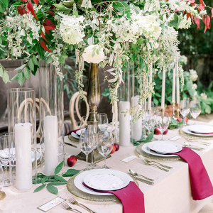 Elegant red wedding tablescape with tall floral centerpieces