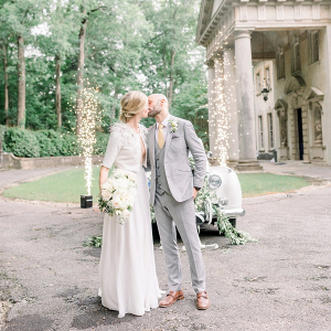 Elegant wedding exit with fireworks and a vintage car