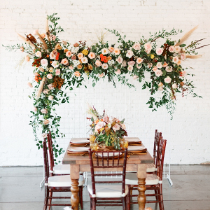 Retro wedding table design with hanging floral installation