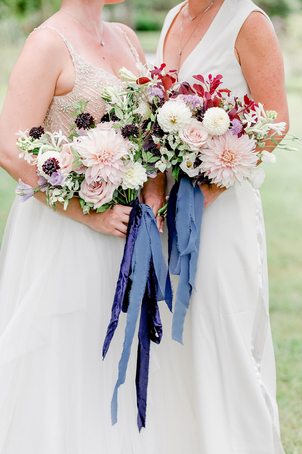 Two brides purple and pink bridal bouquets