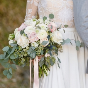Blush bridal bouquet with greenery and ribbon