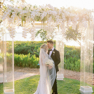 Glam floral covered acrylic ceremony chuppah