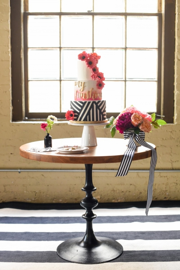 Pink and orange wedding cake with stripes