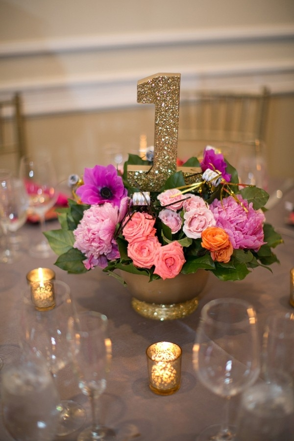 Pink and orange centerpiece with glitter table number