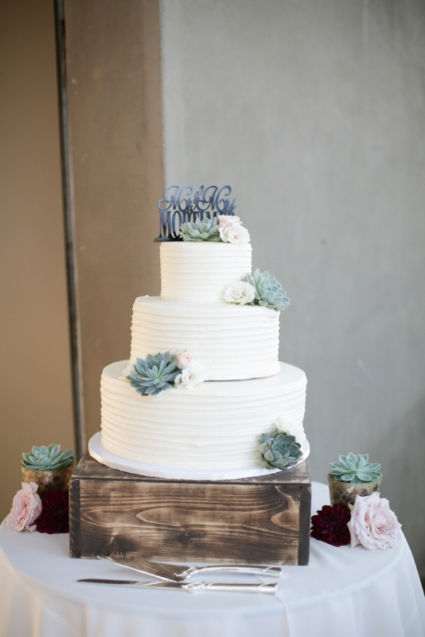 Buttercream wedding cake with succulents