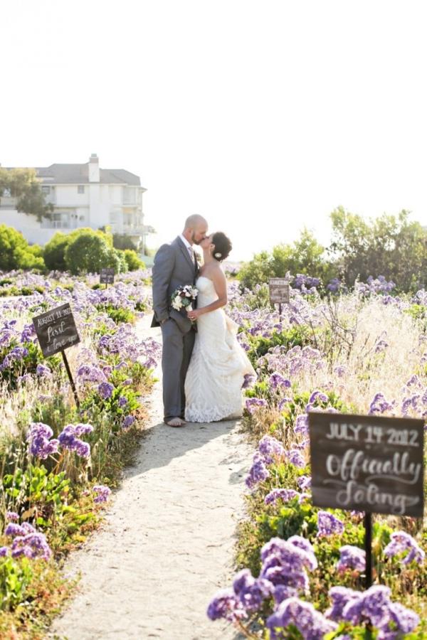 Wedding portrait in a field of flowers