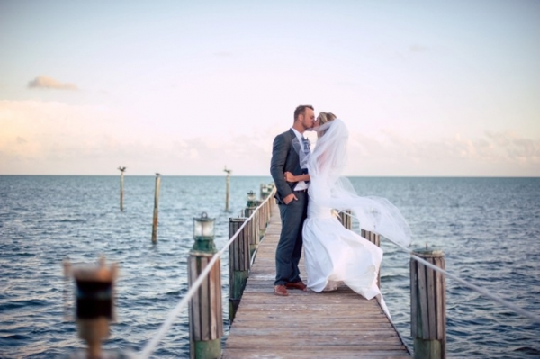 Bride and groom portrait on a dock