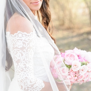 Bride in Lace Dress with Pink Bouquet