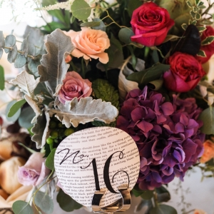 Book Page Table Number With Flourishing Floral Centerpiece