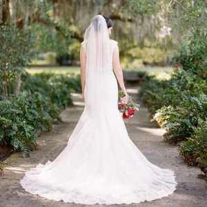 Bride with fanned out wedding gown train