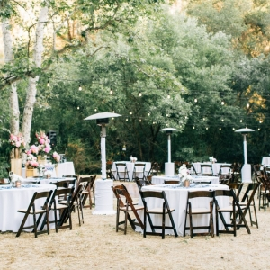Round reception tables with wooden chairs
