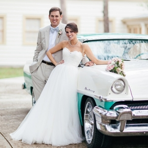 Couple with vintage car
