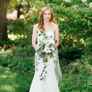 Bride with green and white cascading bouquet
