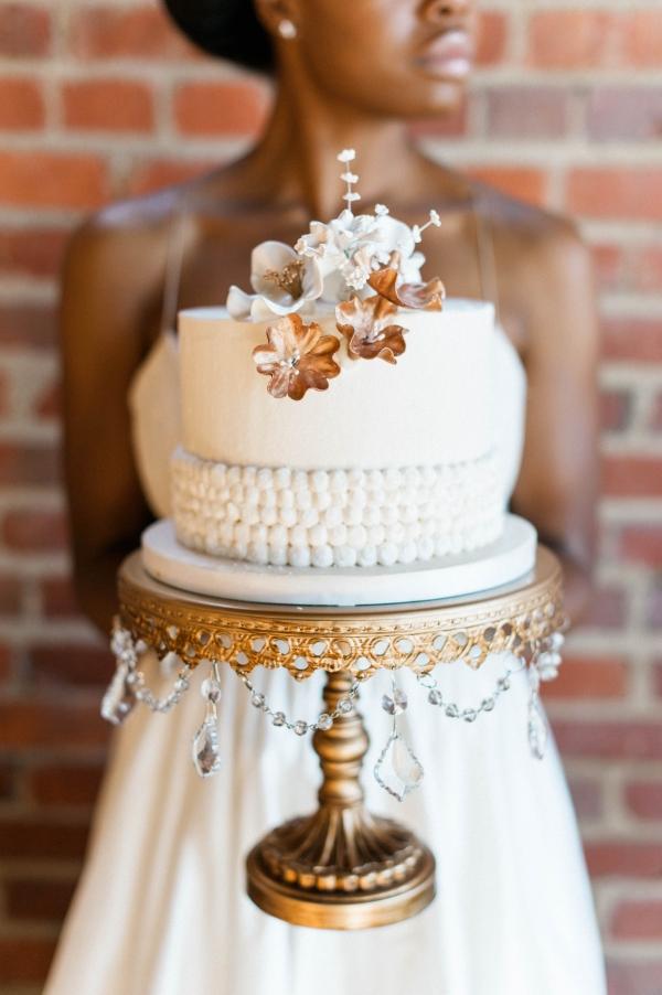 Gold and ivory vintage style wedding cake