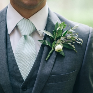 Groom in Gray Suit with a Green & White Boutonniere